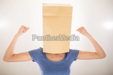 girl with bag covering her head