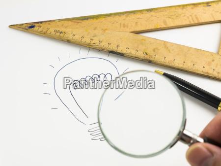 drawn lightbulb set square ballpen and