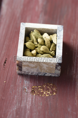 little box of cardamom capsules on