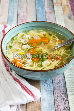 soup bowl of chicken stock with