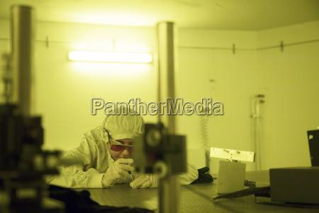 germany female technician working in optical