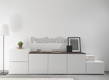 white sidebord in a modern living
