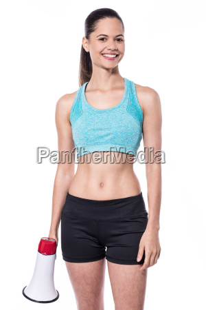 trendy sporty lady holding loudhailer
