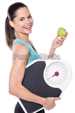 happy lady posing with weighing scale
