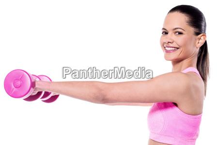 slim young woman enjoying workout