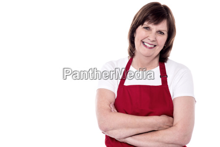 confident aged woman chef smiling