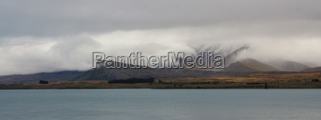 dramatic sky at lake tekapo