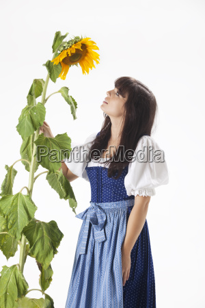 bavarian woman with a sunflower