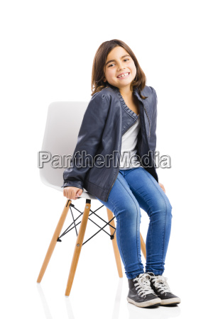 beautiful young girl sitting on a