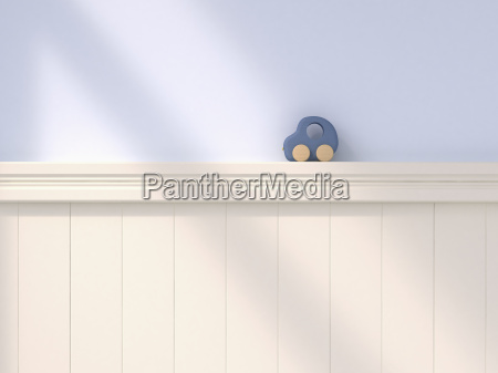 wooden toy car standing on wall