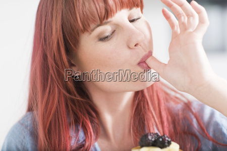 portrait of young woman licking her