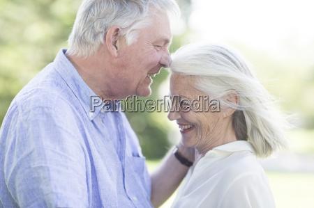intimate senior couple outdoors
