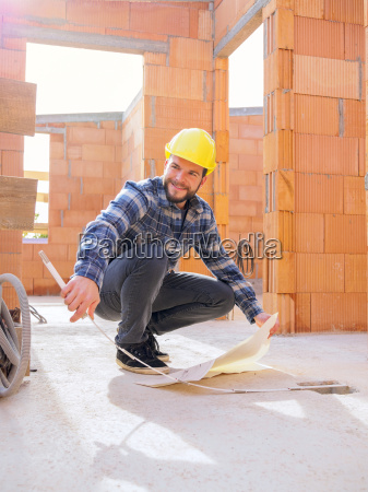 portrait of foreman with construction plan