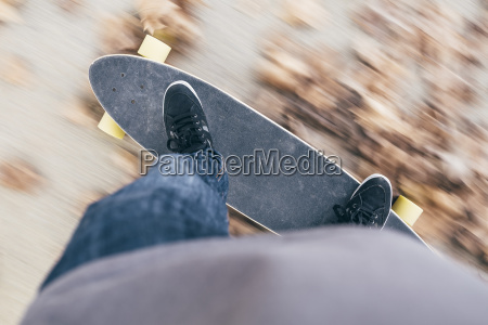 young man driving longboard