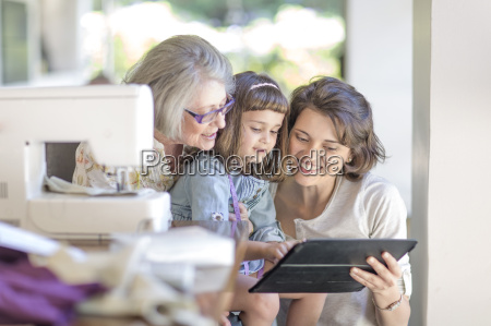 mother daughter and grandmother working on