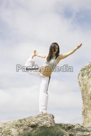 woman doing yoga exercises on a