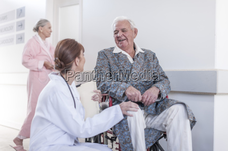 doctor and smiling elderly patient in