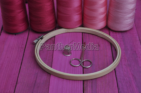 hoop with threads for hand sewing