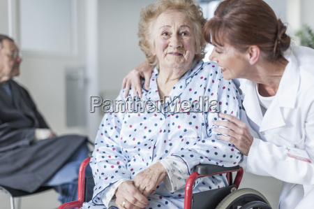 doctor caring for elderly patient in