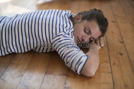 young woman at home lying on