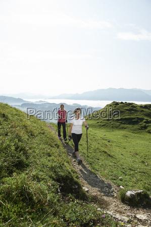 austria two women nordic walking at