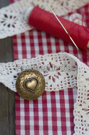 cotton reel sewing needle lace and