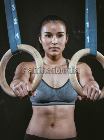 portrait of crossfit athlete with gymnastic