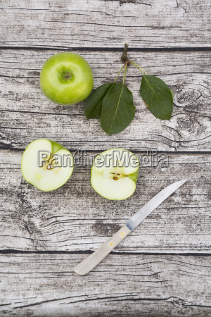 sliced and whole granny smith leaves