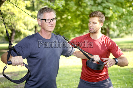man doing trx training while his