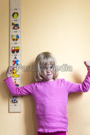 portrait of grimacing little girl standing