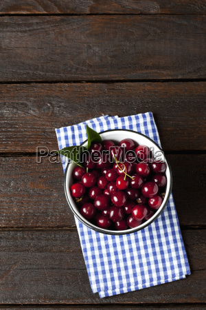bowl of sour cherries on cloth