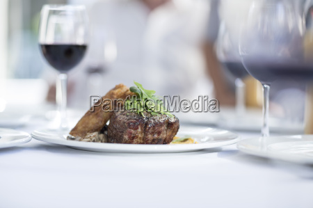 steak and red wine on table