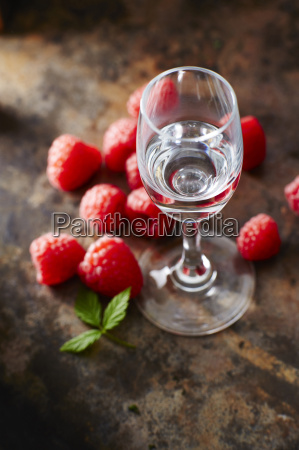 raspberries and glass of raspberry brandy