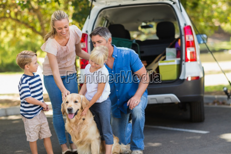 happy family with their dog in