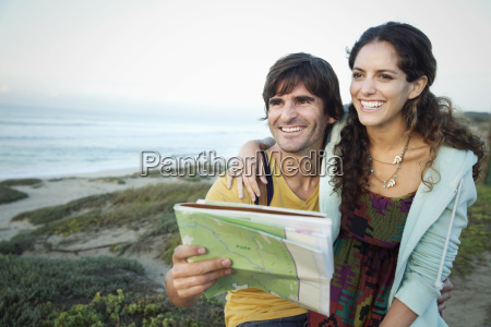 south africa happy couple with map