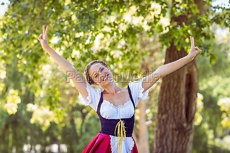 pretty oktoberfest blonde feeling free in