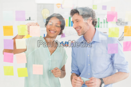 puzzled business team looking post its