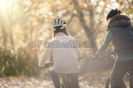mother and daughter bike riding in