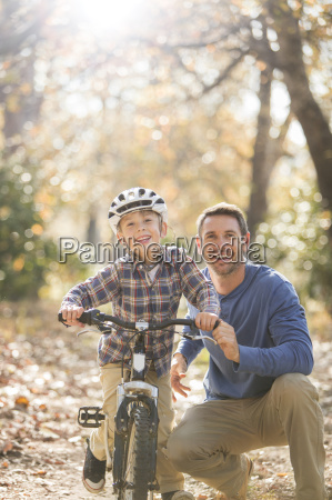 portrait smiling father teaching son to