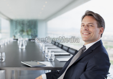 portrait of smiling businessman in conference