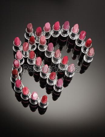 multicolor lipsticks forming euro symbol