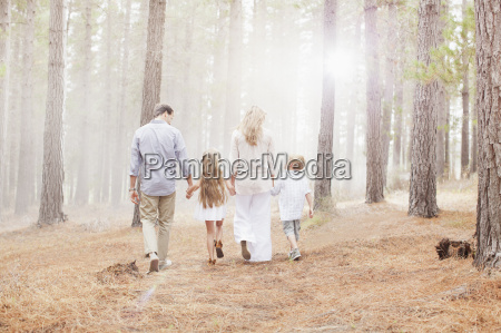 family holding hands and walking in