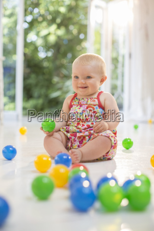 baby girl playing with toys on