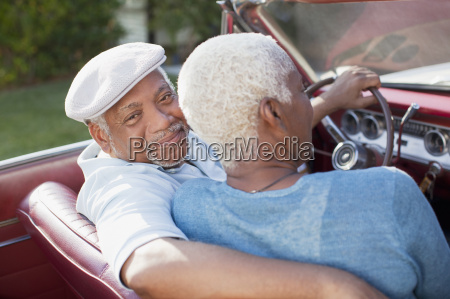 older couple sitting in convertible