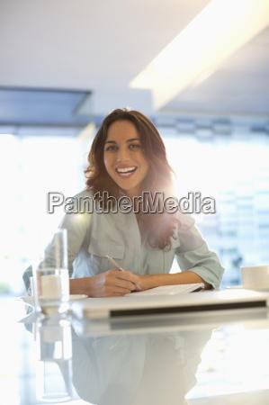 portrait of smiling businesswoman working