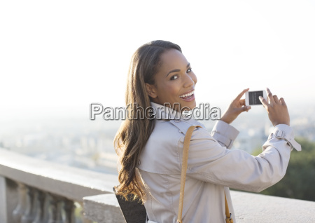 businesswoman taking pictures with cell phone