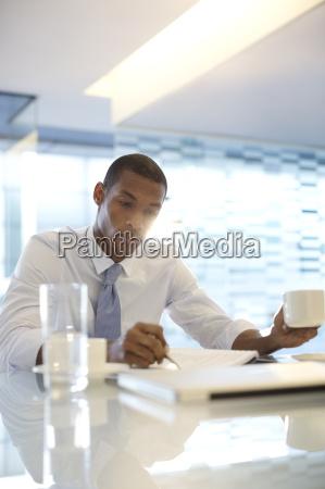 serious businessman reading paperwork