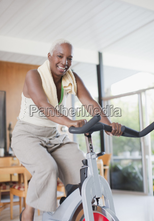 older woman using exercise bike in