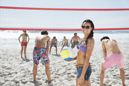 portrait of smiling woman playing beach