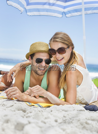 portrait of smiling couple laying on